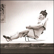 Ray Eames demonstrating lounge chair prototype