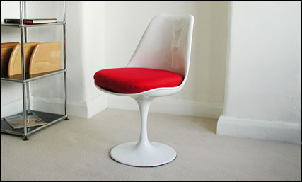 White trumpet chair with red fabric seat pad