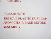 Please note: you must remove the plastic dust cap from chair base before assembly