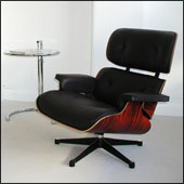 Charles Eames lounge chair with an Eileen Gray adjustable side table